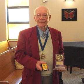 Herman VanDongen with his medal and trophy.