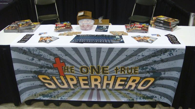 The table at Comic-Con displays Action Bibles and other tracts.
