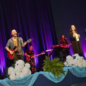 Musician/songwriter Brooke Nicholls and her band led worship at the Inspirational Women's Conference.