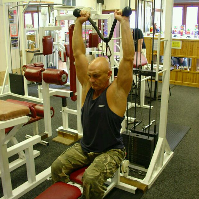 How to do: CM Low Pulley Two Arms Overhead Triceps Extensions - Step 4
