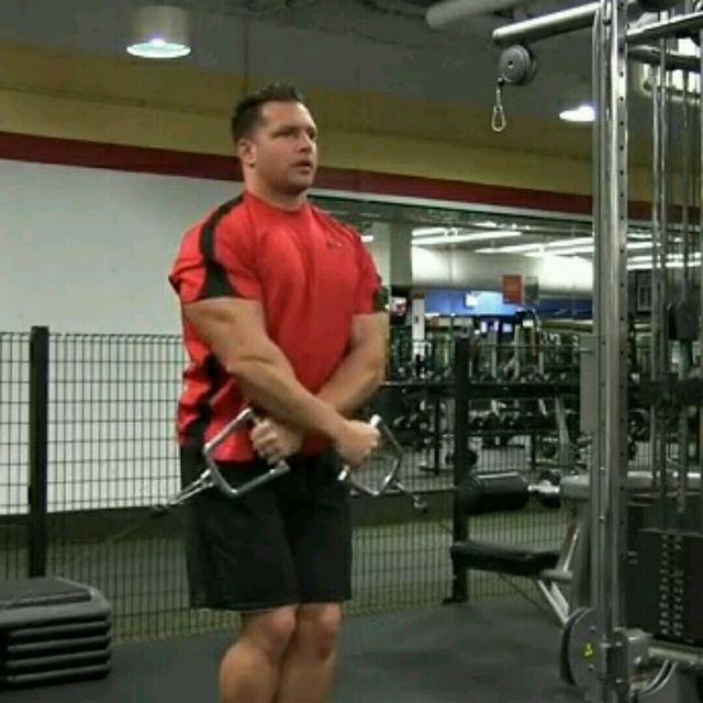 How to do: CM Low Pulley Two Arm Side Lateral Raises - Step 1