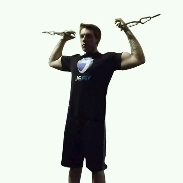 How to do: CM Standing Two Arm Bicep High Curl - Step 2