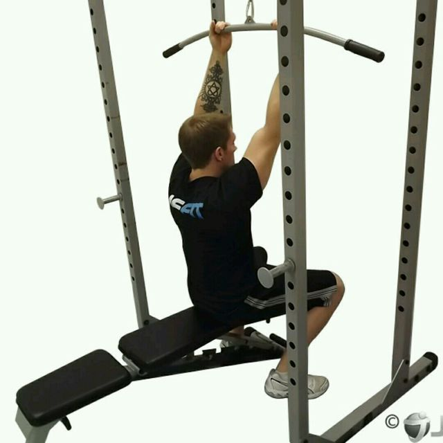 How to do: CM Seated Overhead Bicep Curl Pulldown - Step 1