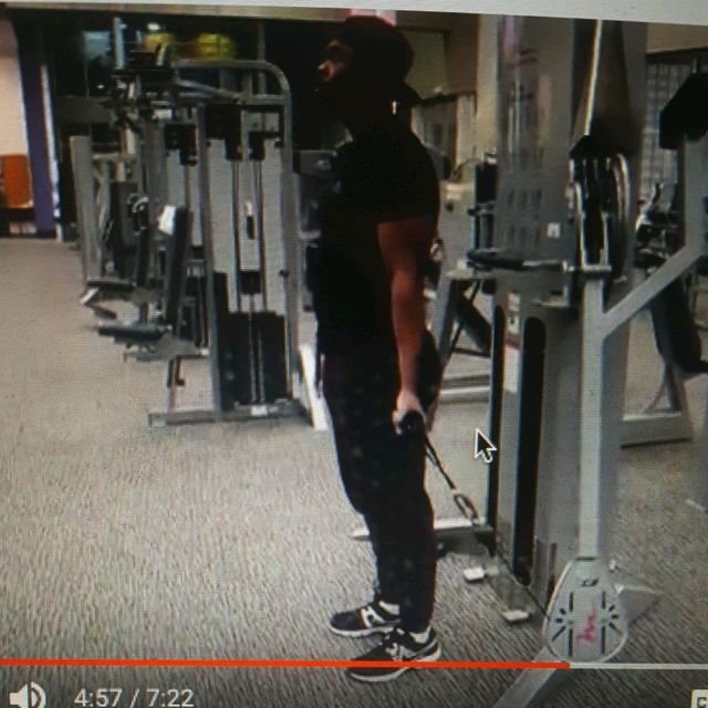 How to do: Standing One Arm Cable Curl - Step 1