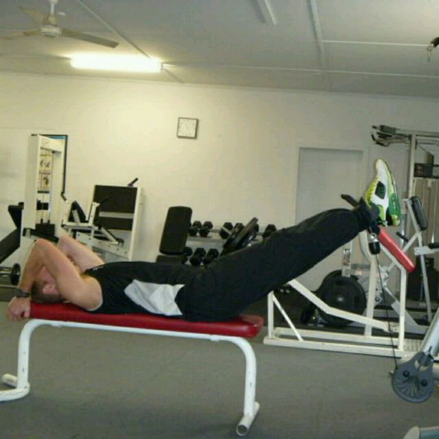 How to do: CM Double Straight Leg Raise On Bench - Step 1