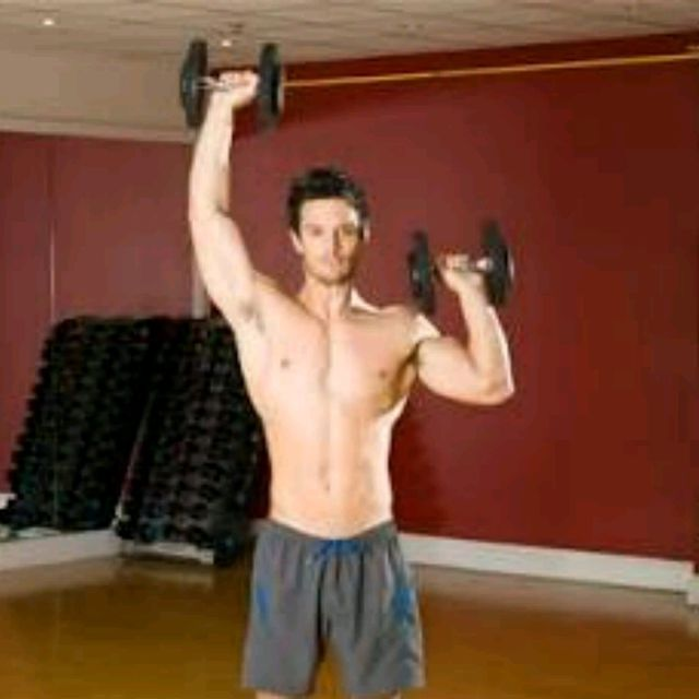 How to do: Standing Alternating Dumbell Press - Step 1