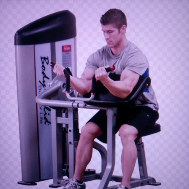 How to do: Bicep Curl Machine - Step 1
