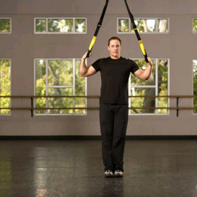How to do: TRX Assisted Side Lunge with Arm Raise - Step 1