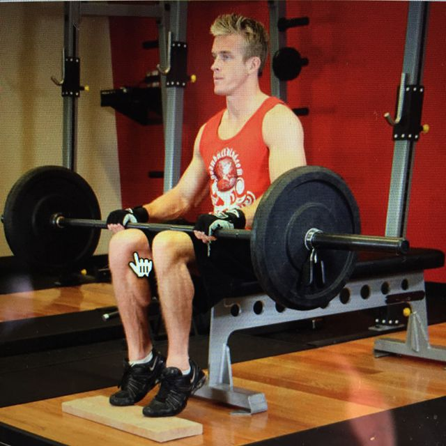How to do: Barbell Seated Calf Raises - Step 1