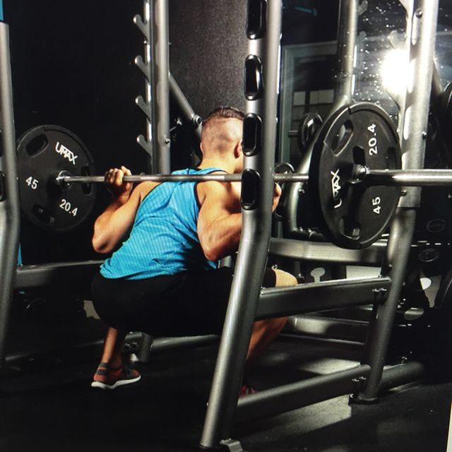 How to do: Wide-stance Barbell Squat - Step 1