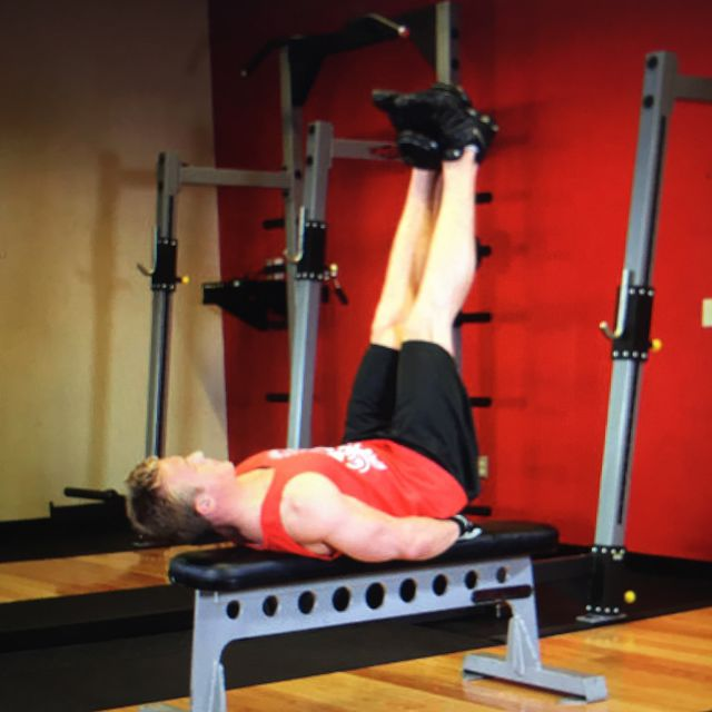 How to do: FlatBench Lying Leg Raise - Step 1