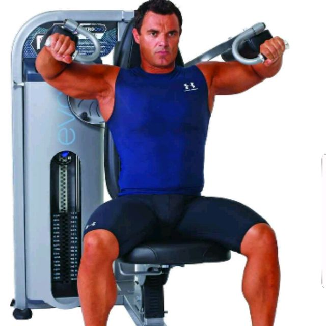 How to do: Lateral Raise Machine - Step 1