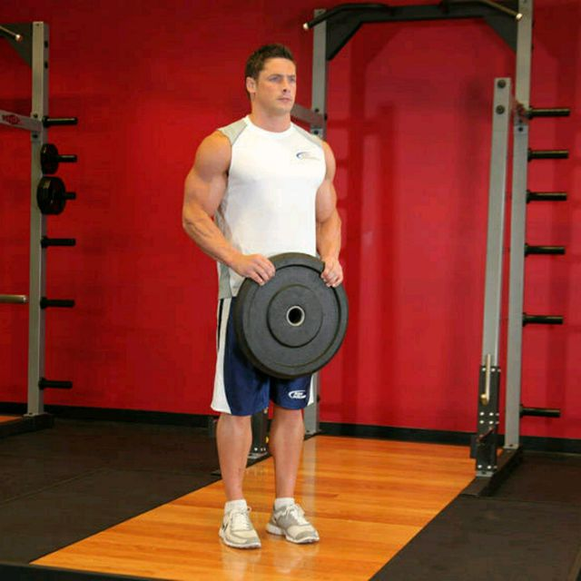 How to do: Reverse Plate Curls Images - Step 1