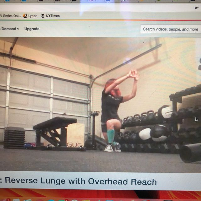How to do: Reverse Lunge Overhead Reach - Step 1