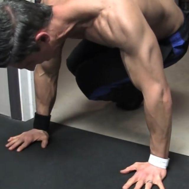 How to do: Sliding Twisting Knee Tucks - Step 1
