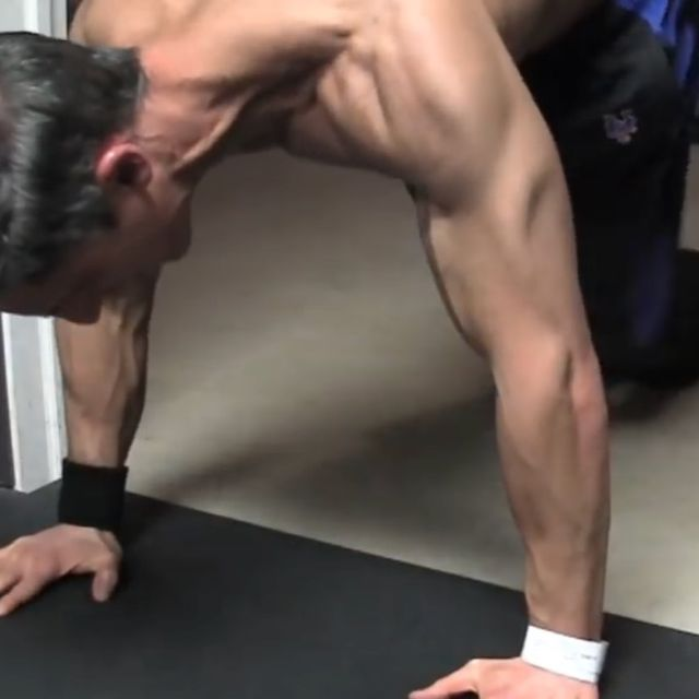How to do: Sliding Twisting Knee Tucks - Step 2