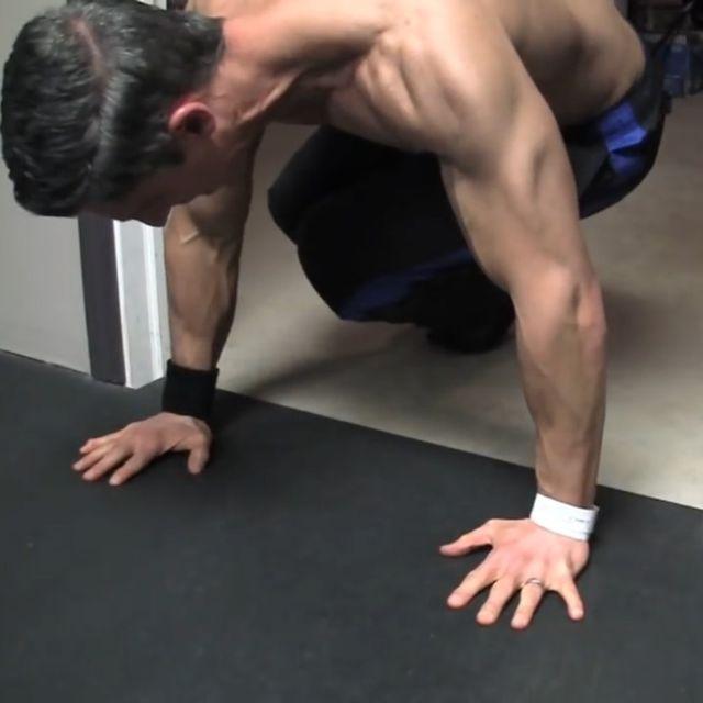 How to do: Sliding Twisting Knee Tucks - Step 3