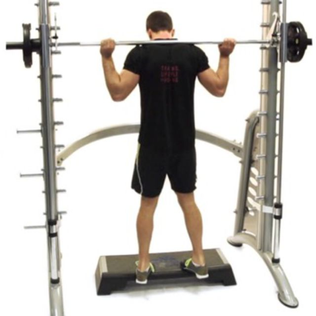 How to do: Smith Machine Calf Raises [Toes In] - Step 1
