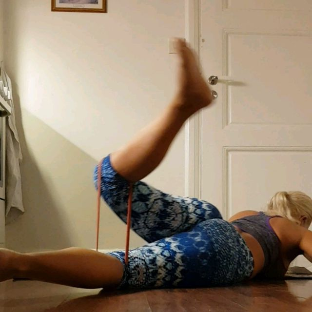 How to do: Lying Scorpion With Resistance Band - Step 1