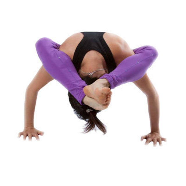 With legs wrapped behind your head, ease onto your hands placed a little more than shoulder width apart.