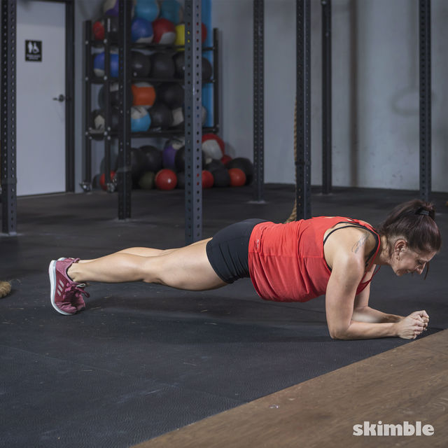 How to do: Elbow Plank Hop Outs - Step 1