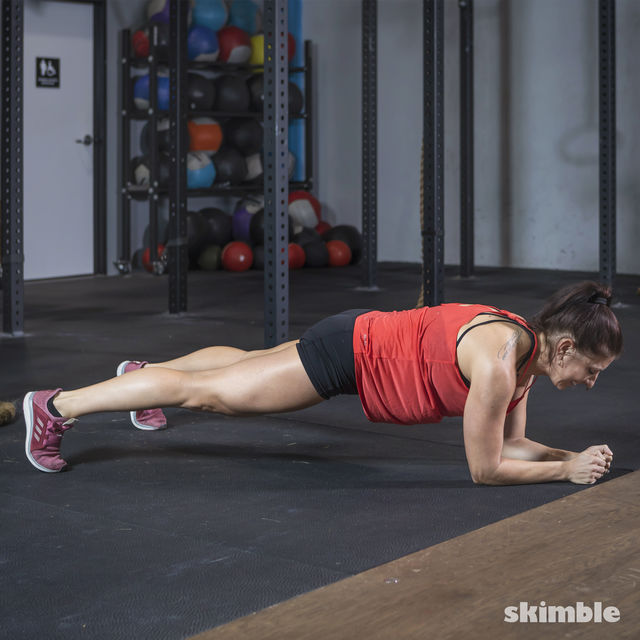 How to do: Elbow Plank Hop Outs - Step 2