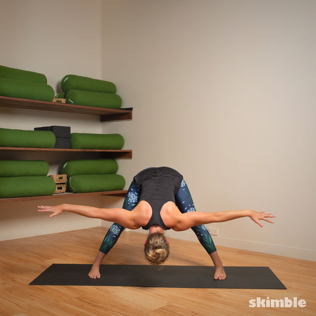 How to do: Standing Separate Leg Stretching Pose - Step 7