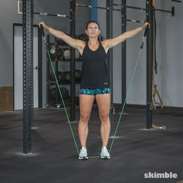 How to do: Lateral Shoulder Raises with Band - Step 4