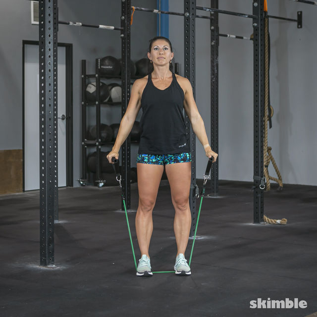 How to do: Lateral Shoulder Raises with Band - Step 6
