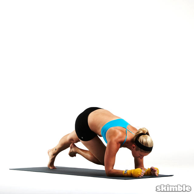 How to do: Mini Scorpion Elbow Plank - Step 2
