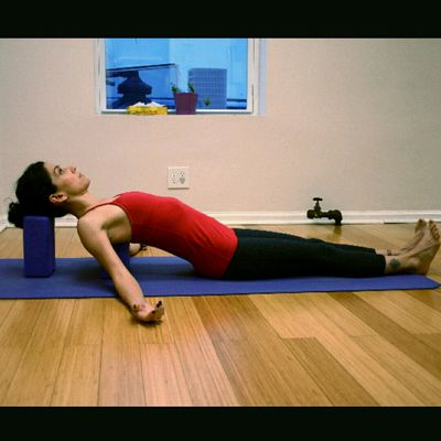 Supported Fish Pose (Use Block Or Pillow Under Shoulders)