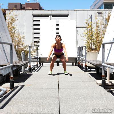 Sentadillas con salto hacia adelante
