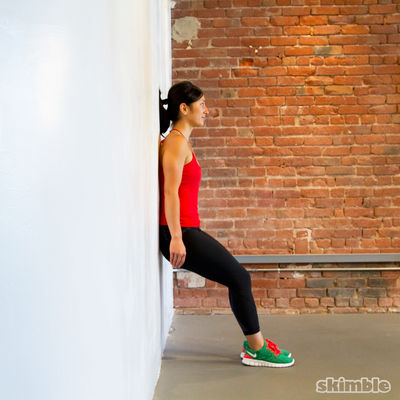Wall Sit Add Bicep Curls For Time Of 8 Reps Both Arms At Same Time