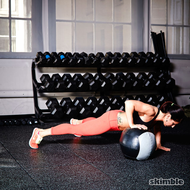 How to do: Medicine Ball Offset Push-Ups - Step 1
