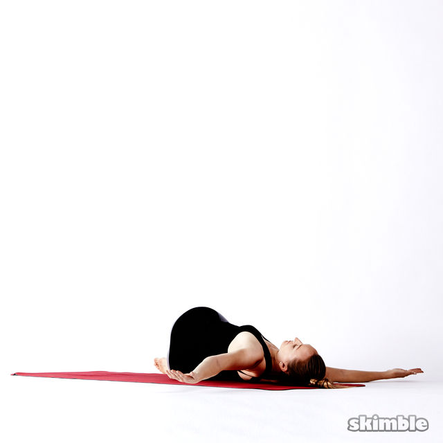 How to do: Lying Spinal Twist with Crossed Legs - Step 9