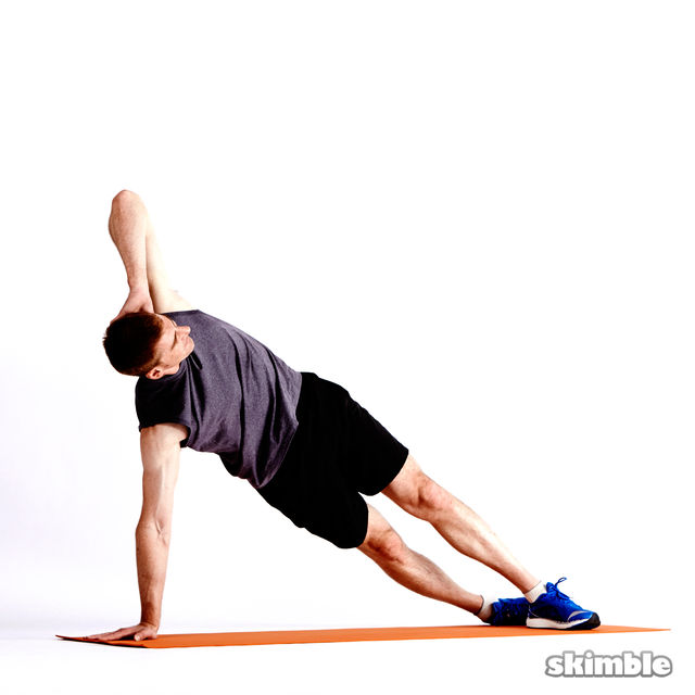How to do: Left Elbow to Opposite Knee Side Plank - Step 4