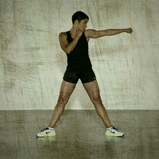 How to do: Sumo Squat Jabs - Step 3
