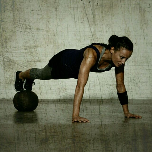 How to do: Med Ball High Push-Ups - Step 1