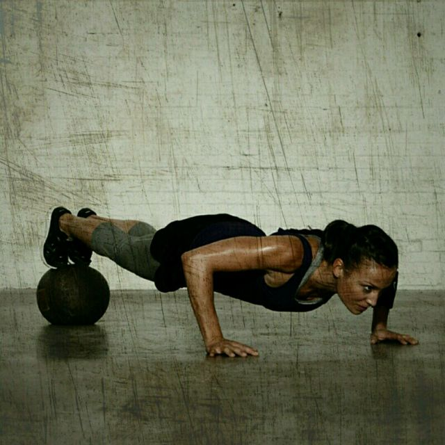 How to do: Med Ball High Push-Ups - Step 2