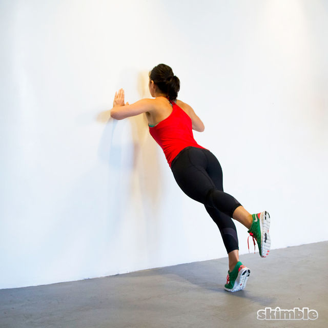 How to do: Wall Push-Ups with Leg Lifts - Step 6