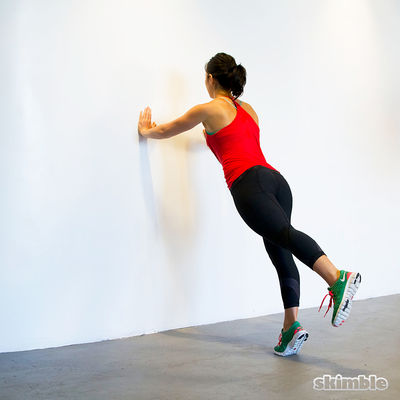 Wall Push-Ups with Leg Lifts