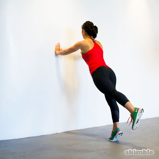 How to do: Wall Push-Ups with Leg Lifts - Step 4