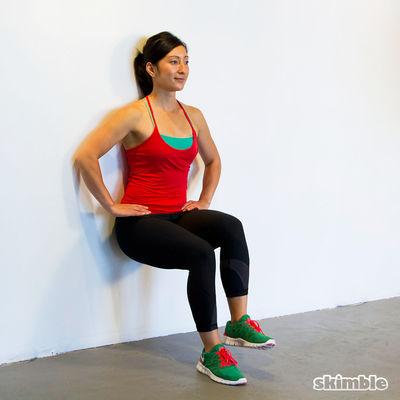 Sentadillas estáticas con elevación de rodillas