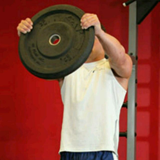 How to do: Front Plate Raise With Heavy Weight - Step 1
