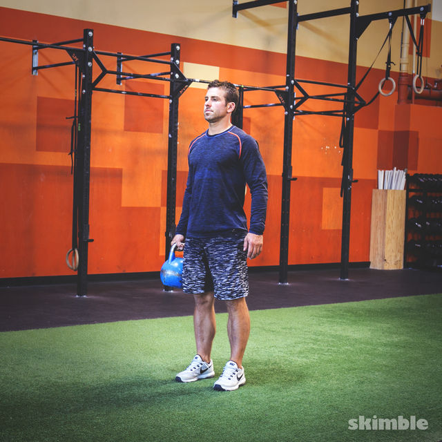 How to do: Left Reverse Lunges with Kettlebell - Step 1