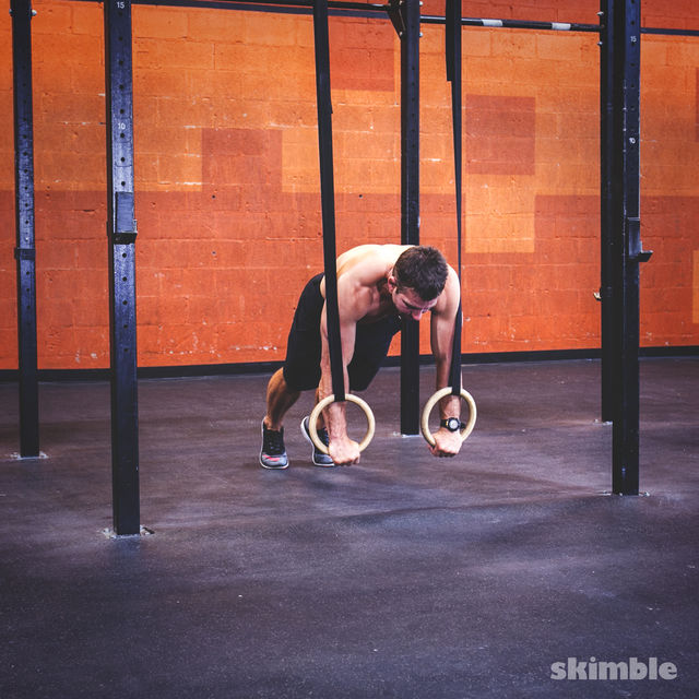 How to do: Ring Plank Knee Draw - Step 1