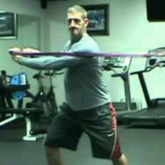 How to do: Torso Twist with Resistance Band - Step 1