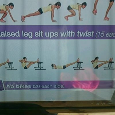 Raised Leg Sit Ups With Twist