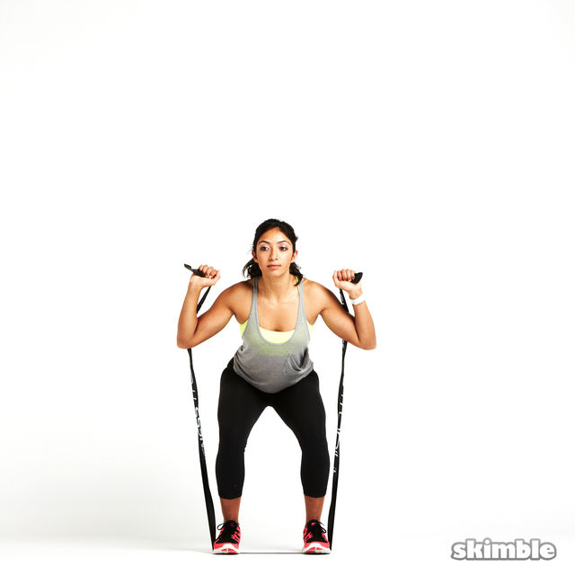 How to do: Squats to Shoulder Press with Band - Step 2
