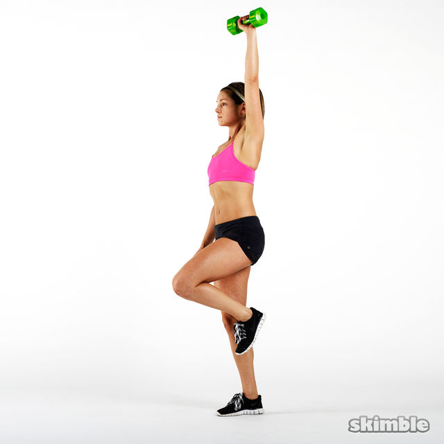 How to do: Dumbbell Right Leg Curl to Press - Step 3